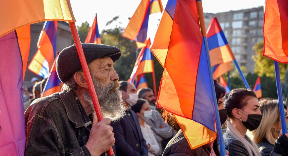 An elderly protests during a rally against the country's agreement to end fighting with Azerbaijan over the disputed Nagorno-Karabakh region in Yerevan on November 12, 2020.