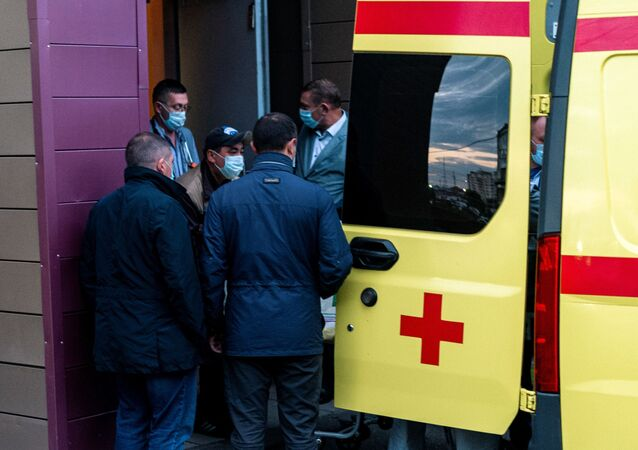 Medics load Alexei Navalny in an ambulance at Omsk Emergency Hospital No 1 where Navalny was admitted after he fell ill in what his spokeswoman said was a suspected poisoning in Omsk on August 22, 2020. -