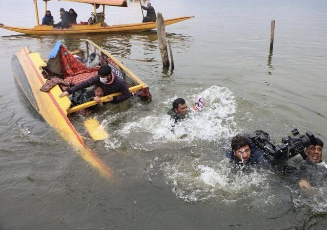 A major mishap was averted today after a boat carrying four Bharatiya Janata Party (BJP) members and several cameramen during an election rally overturned, causing everyone an impromptu dip in the freezing waters of Srinagar's Dal Lake.