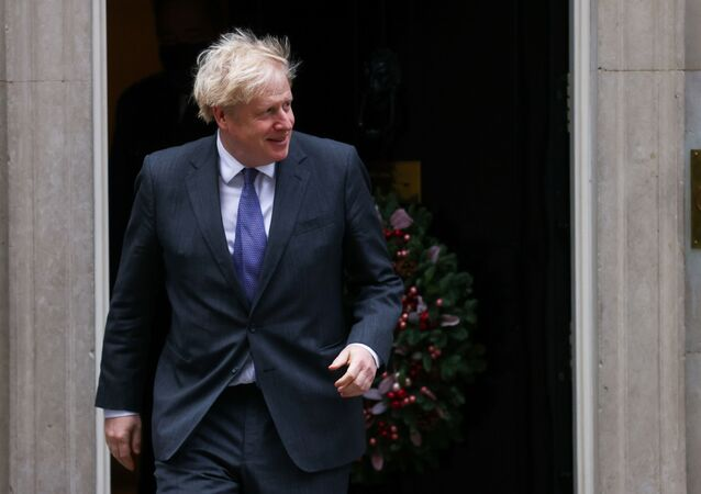 British Prime Minister Boris Johnson goes to meet Abu Dhabi's Crown Prince Sheikh Mohammed bin Zayed Al Nahyan (not pictured) in Downing Street, London, Britain, 10 December 2020.