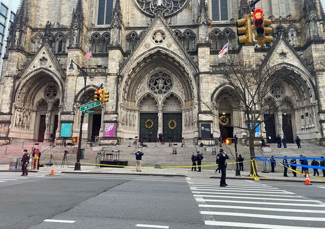 Police are seen outside of the Cathedral of St. John the Divine in New York on December 13, 2020, after a shooter opened fire outside the church before police returned fire and took the man into custody.