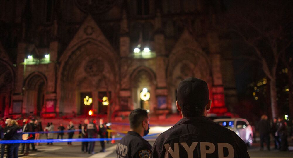 Police officers stand guard outside of the Cathedral of St. John the Divine in New York on December 13, 2020, after a shooter opened fire outside the church. - A man was shot and critically injured by police after he opened fire near crowds who had gathered to watch carol-singing outside a New York church.