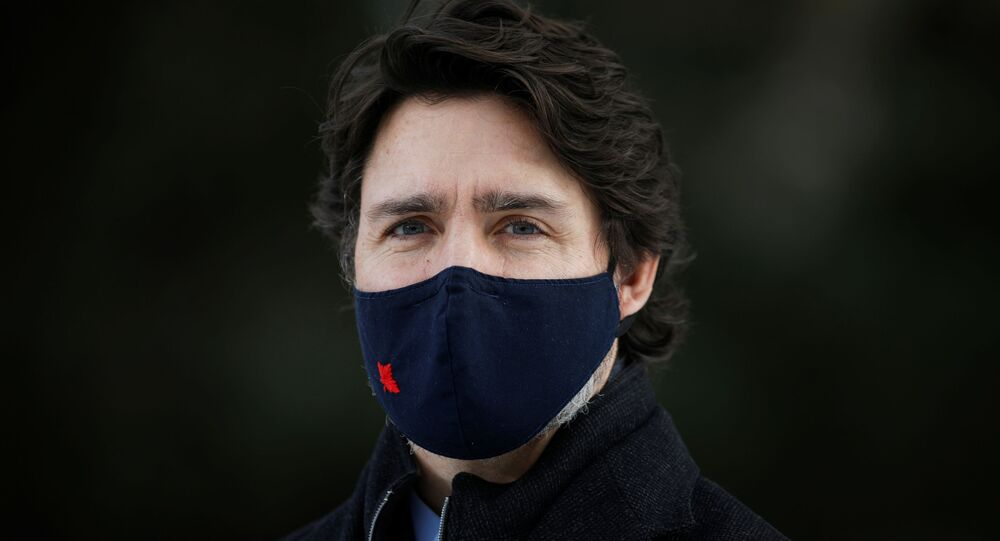 Canada's Prime Minister Justin Trudeau attends a news conference at the Dominion Arboretum in Ottawa, Ontario, Canada December 11, 2020.