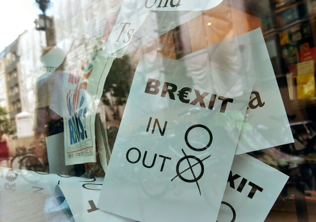 (FILES) In this file photo taken on June 24, 2016 a poster featuring a Brexit vote ballot with out tagged is on display at a book shop window in Berlin.