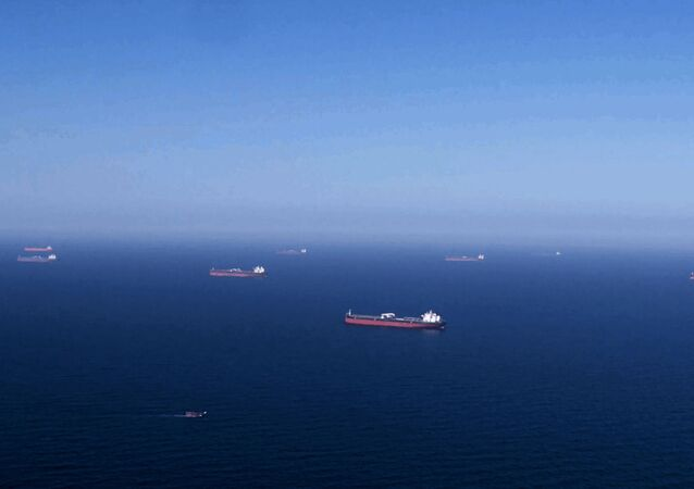 (FILES) In this handout file picture provided by the Saudi Arabian Oil Company (Saudi Aramco) on April 1, 2020 Aramco tankers are pictured being loaded with oil at an undisclosed sea location. - An explosion rocked a Singapore-flagged oil tanker off the Saudi port city of Jeddah on December 14, 2020