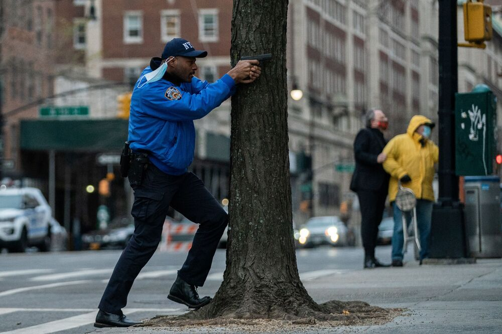 A police officer stands guard while a man is shooting outside the Cathedral Church of St. John the Divine in the Manhattan borough of New York City, New York, U.S., December 13, 2020