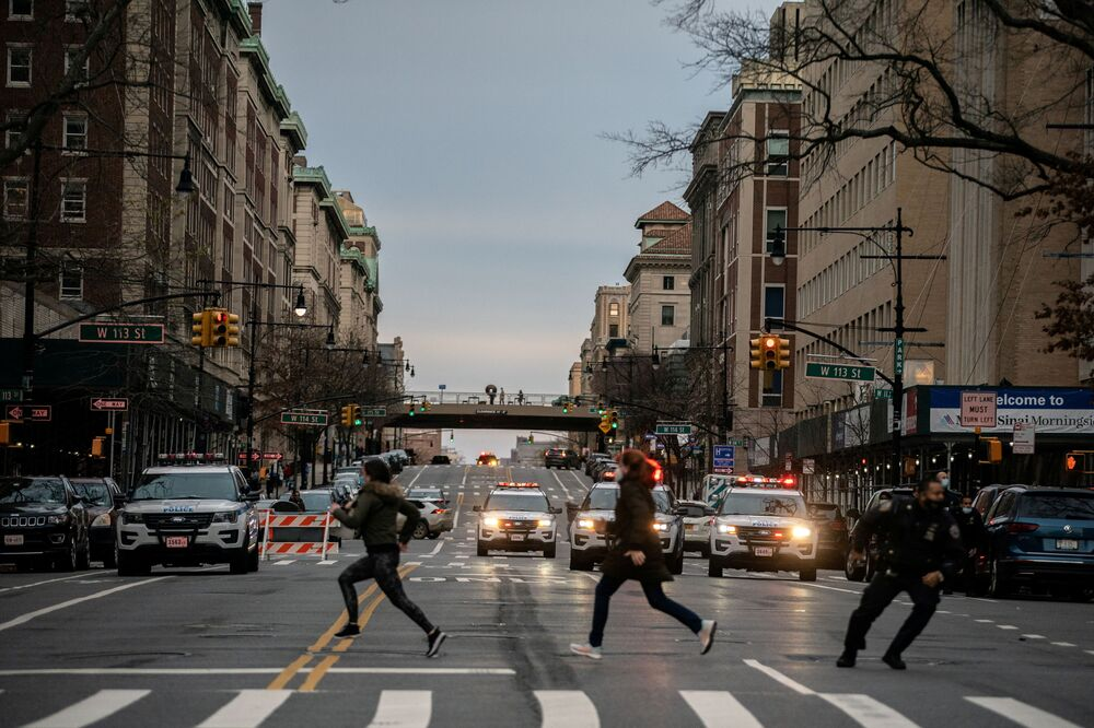 People run after a man opened fire outside the Cathedral Church of St. John the Divine in the Manhattan borough of New York City, New York, U.S., December 13, 2020