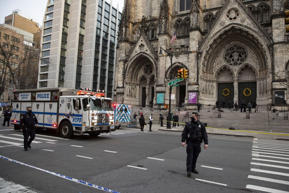New York police officers block off the scene of a shooting at the Cathedral Church of St. John the Divine, Sunday, Dec. 13, 2020, in New York.