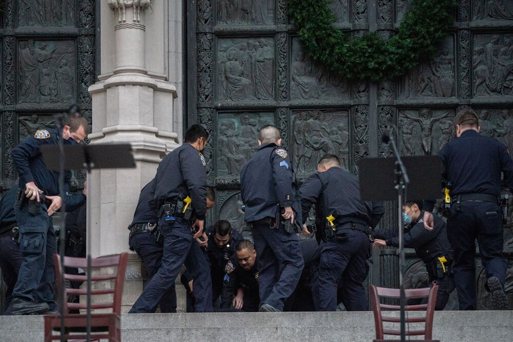Police officers detain a man who opened fire outside the Cathedral Church of St. John the Divine in the Manhattan borough of New York City, New York, U.S., December 13, 2020