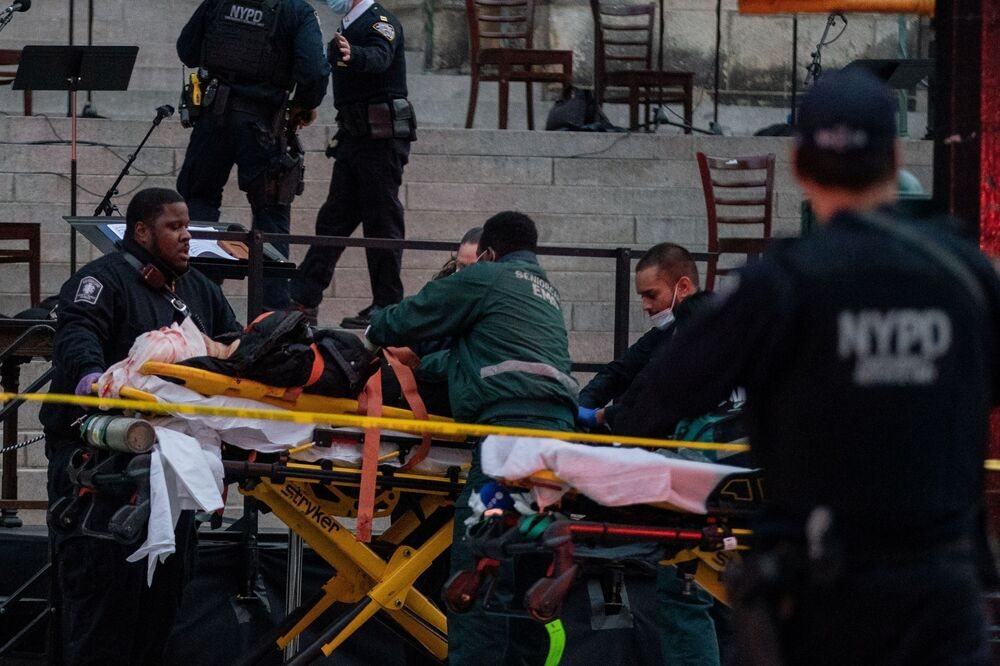 A suspect is taken to an ambulance at the scene where he opened fire outside the Cathedral Church of St. John the Divine in the Manhattan borough of New York City, New York, U.S., December 13, 2020.