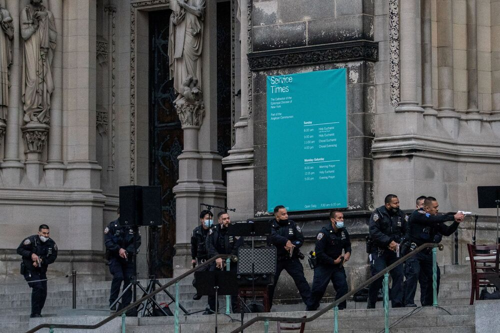 Police officers are seen outside the Cathedral Church of St. John the Divine, after a man opened fire outside the church, in the Manhattan borough of New York City, New York, U.S., December 13, 2020.
