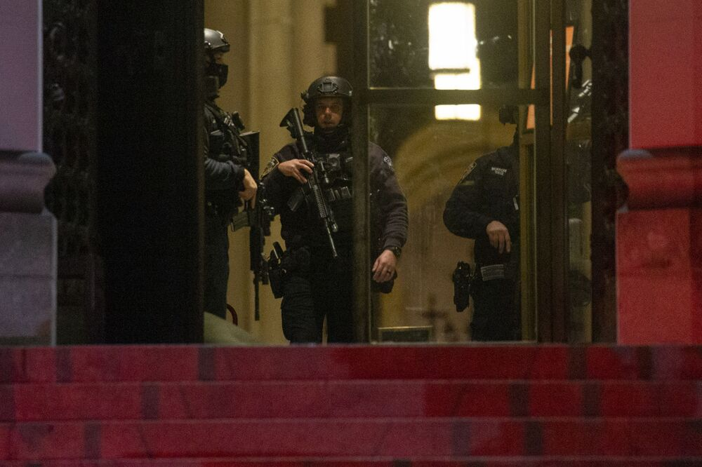 Police patrol inside  the Cathedral of St. John the Divine in New York on December 13, 2020, after a shooter opened fire outside the church