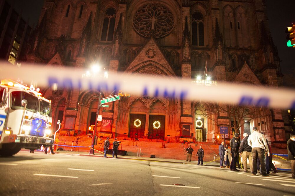 Police are seen outside of the Cathedral of St. John the Divine in New York on December 13, 2020, after a shooter opened fire outside the church.