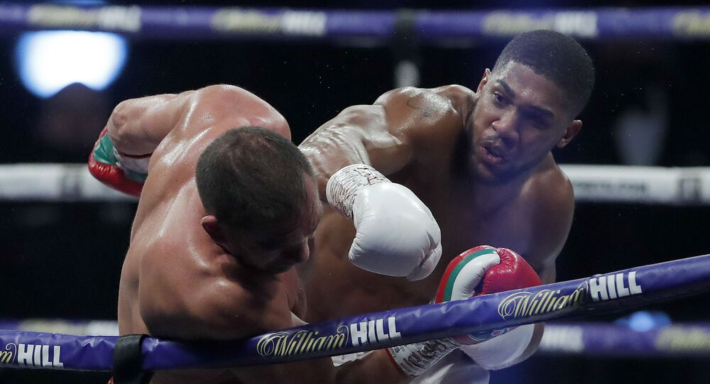 Britain's Anthony Joshua punches Bulgarian Kubrat Pulev during their world heavyweight championship fight on 12 December 2020