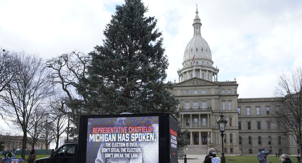 Motorists participate during a drive-by rally to certify the presidential election results near the Capitol building in Lansing, Michigan, Saturday, 14 November 2020