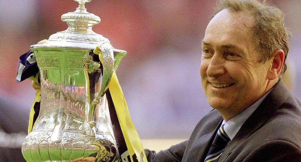 FILE PHOTO: Soccer Football - FA Cup Final - Liverpool v Arsenal - Millennium Stadium, Cardiff, Wales, Britain - 12 May 2001  Liverpool's manager Gerard Houllier holds aloft the FA Cup