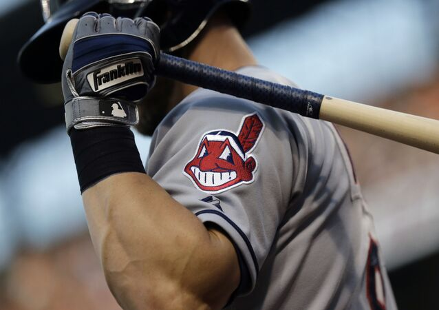 FILE - This June 26, 2015, file photo, shows the Cleveland Indians logo on a jersey during a baseball game against the Baltimore Orioles in Baltimore