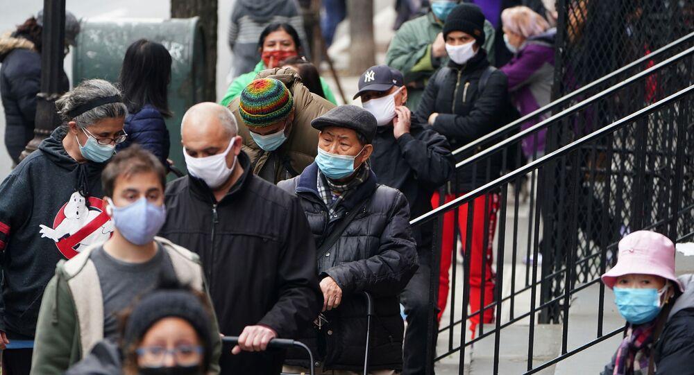 People wait in line at the St. Clements Food Pantry for food during the coronavirus disease (COVID-19) pandemic in the Manhattan borough of New York City, New York, 11 December 2020.