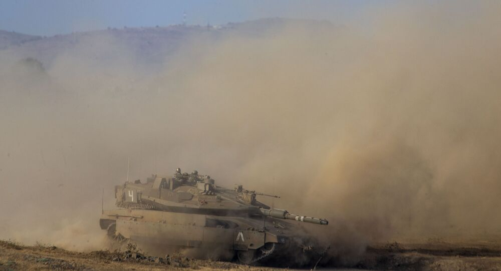 Israeli soldiers drive a tank during an exercise in the Israeli controlled Golan Heights near the border with Syria, Tuesday, Aug. 4, 2020
