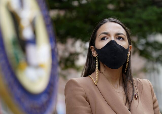 Rep. Alexandria Ocasio-Cortez, D-NY, wears a protective mask as she waits to speak during a news conference outside the USPS Jamaica station, Tuesday, Aug. 18, 2020, in the Queens borough of New York. The Postal Service said it has stopped removing mailboxes and mail-sorting machines amid an outcry from lawmakers, as President Donald Trump denied he was slowing service. Democrats and some Republicans say actions by a Trump ally and a major Republican donor, new Postmaster General Louis DeJoy, have endangered millions of Americans who rely on the Postal Service for prescription drugs and other needs.