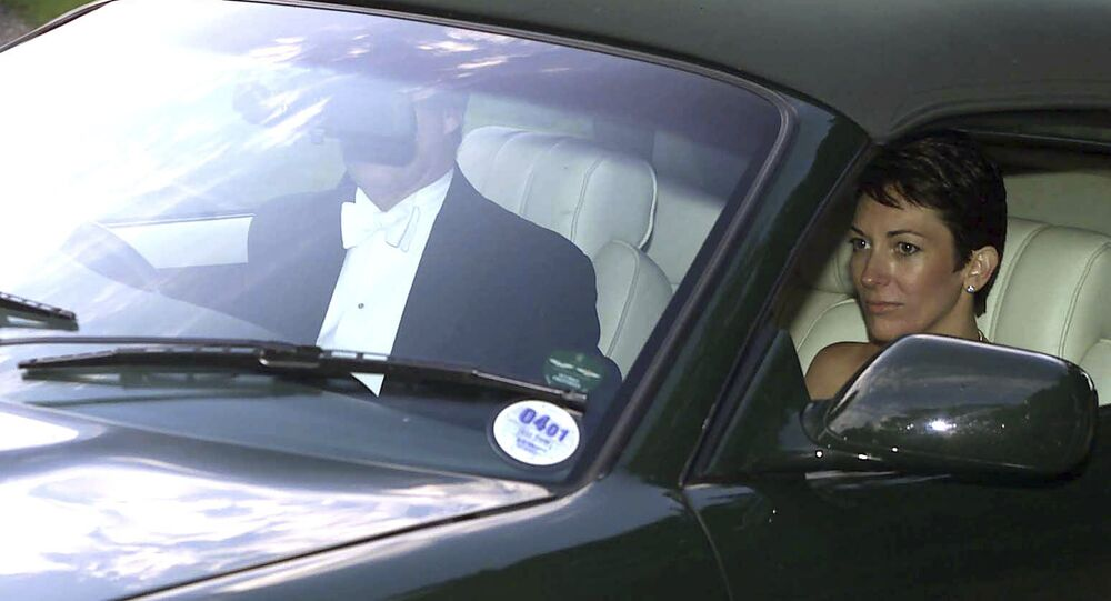 n this Sept. 2, 2000 file photo, British socialite Ghislaine Maxwell, driven by Britain's Prince Andrew leaves the wedding of a former girlfriend of the prince, Aurelia Cecil, at the Parish Church of St Michael in Compton Chamberlayne near Salisbury, England. The FBI said Thursday July 2, 2020, Ghislaine Maxwell, who was accused by many women of helping procure underage sex partners for Jeffrey Epstein, has been arrested in New Hampshire.