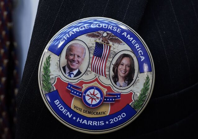 Electoral College elector Mark Miller wears a Joe Biden and Kamala Harris button after electors cast their votes for President of the United States at the state Capitol, Monday, Dec. 14, 2020 in Lansing, Mich.
