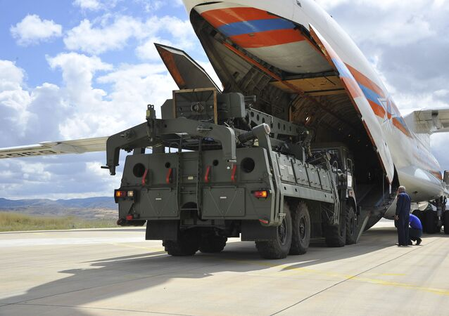 Military vehicles and equipment, parts of the S-400 air defense systems, are unloaded from a Russian transport aircraft, at Murted military airport in Ankara, Turkey, Friday, July 12, 2019