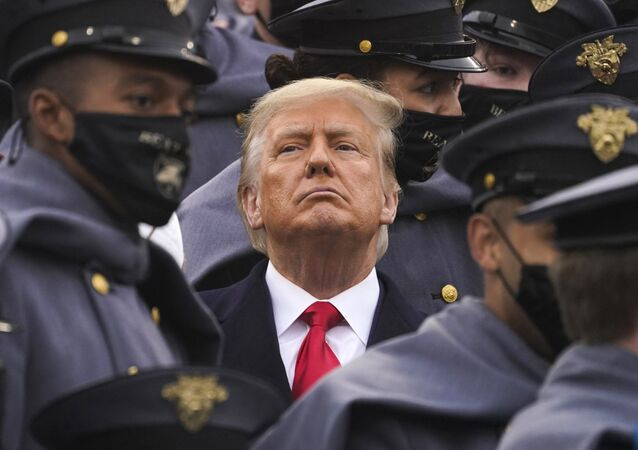 Surrounded by Army cadets, President Donald Trump watches the first half of the 121st Army-Navy Football Game in Michie Stadium at the United States Military Academy, Saturday, Dec. 12, 2020