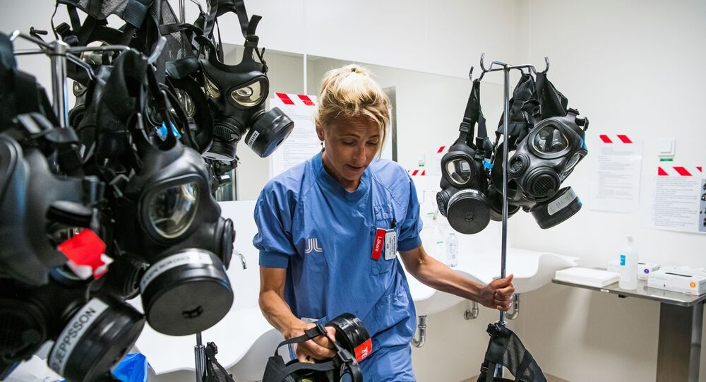 Karin Hildebrand, a doctor in an intensive care unit (ICU) in Stockholm's Sodersjukhuset hospital cleans and disinfects a protective face mask after treating patients with COVID-19 on June 11, 2020, during the coronavirus COVID-19 pandemic