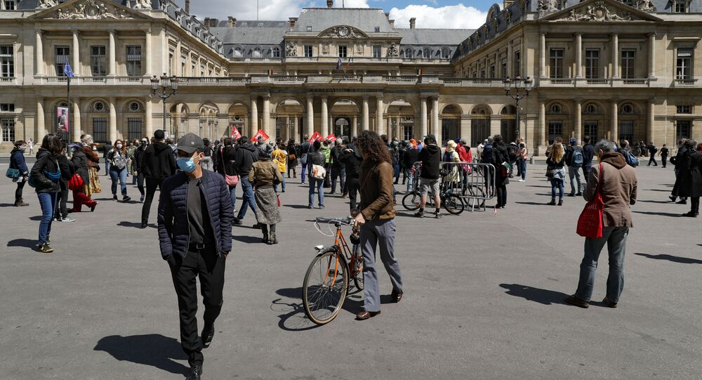 Protesters gather Place du Palais Royal during a demonstration of cultural, artistic and entertainment professionals calling for concrete measures for their sector, hard-hit by the lockdown imposed to curb the spread of the COVID-19 (novel coronavirus) pandemic, on June 6, 2020, in Paris.