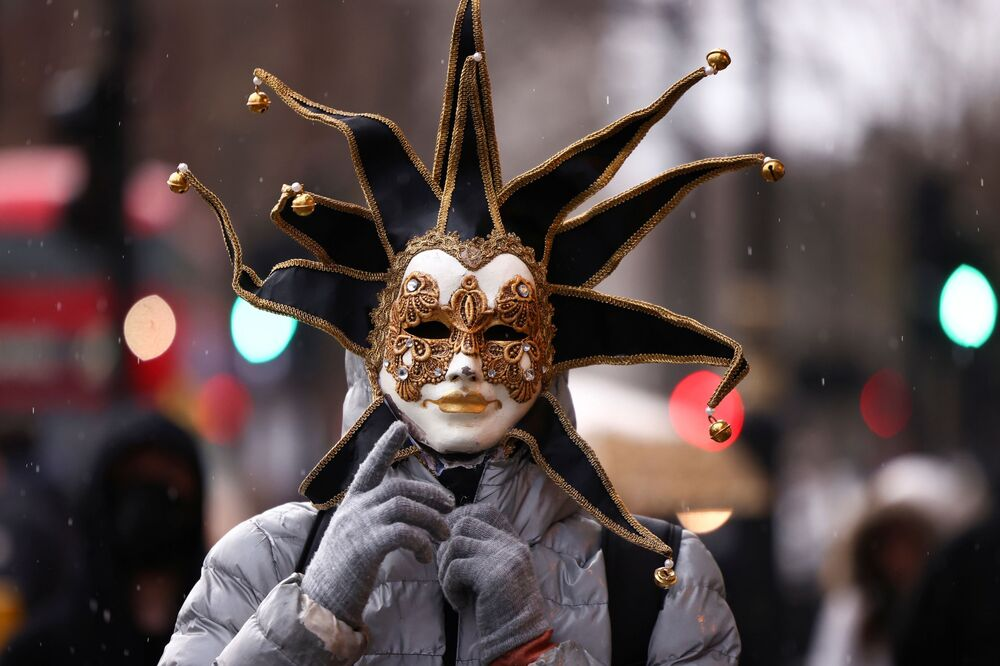A person wearing a mask participates in an anti-vaccination demonstration at the Parliament Square in London, Britain, 14 December 2020.