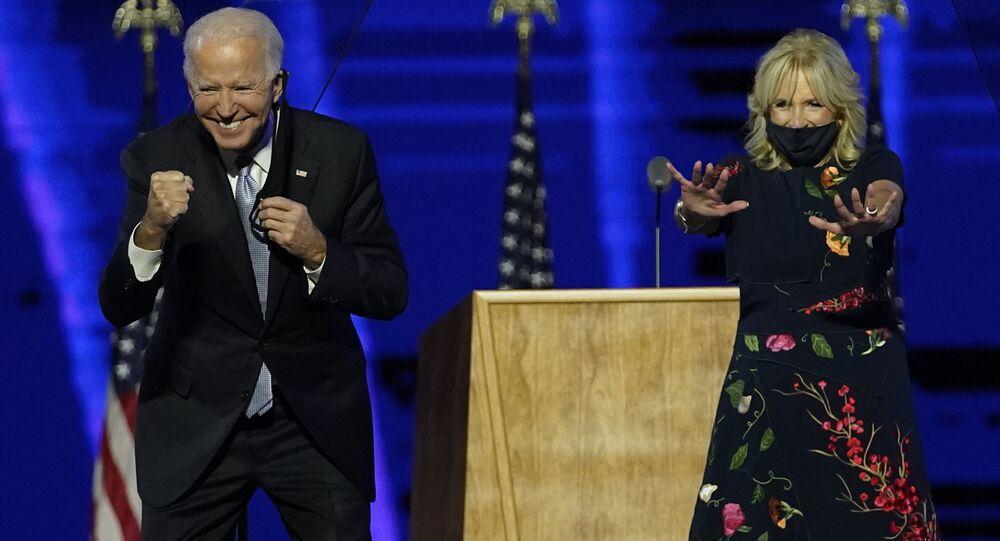 President-elect Joe Biden and wife Jill Biden gesture to supporters Saturday, Nov. 7, 2020, in Wilmington, Del.