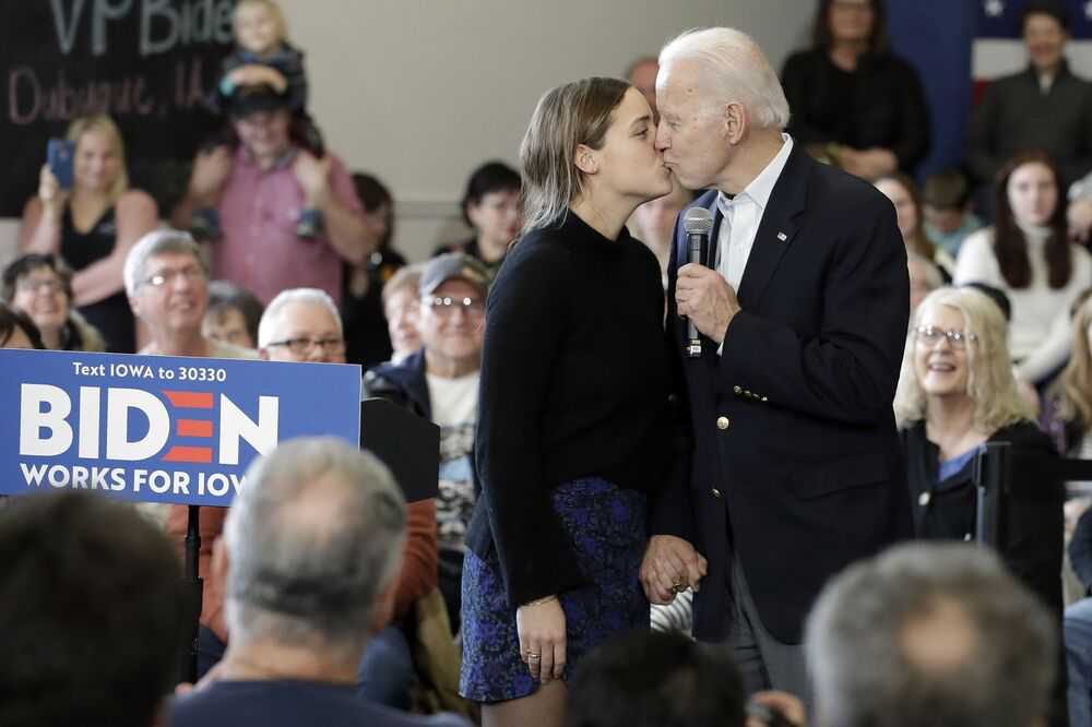 Democratic presidential candidate former Vice President Joe Biden, right, kisses his granddaughter Finnegan Biden during a campaign event on 2 February, 2020 in Dubuque, Iowa.