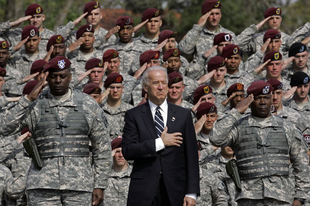 Vice President Joe Biden, centre, during the National Anthem at a welcome home ceremony at Fort Bragg, N.C., Wednesday, April 8, 2009.