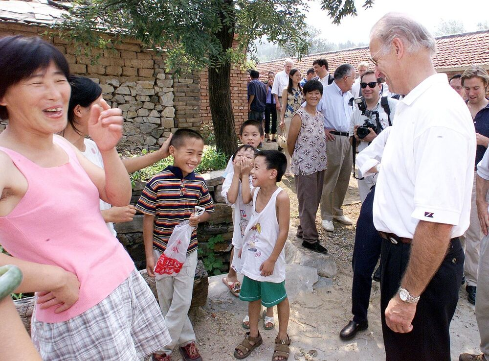 Villagers laugh as US Senate Foreign Relations Committee Chairman Joseph Biden (R) proclaims nine-year-old Gao Shan (3rd L-in the striped shirt) as the future president of China, during a visit to the village of Yanzikou, north of Beijing on 10 August, 2001.