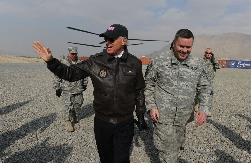 US Vice President Joe Biden (L) arrives for a visit at an Afghan National Army (ANA) training center in Kabul on 11 January, 2011.