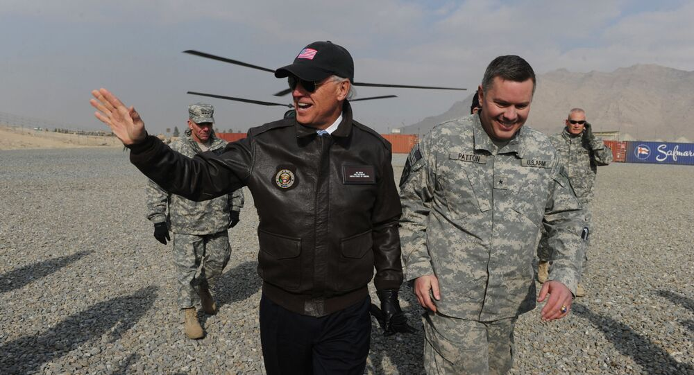US Vice President Joe Biden (L) arrives for a visit at an Afghan National Army (ANA) training center in Kabul on January 11, 2011.