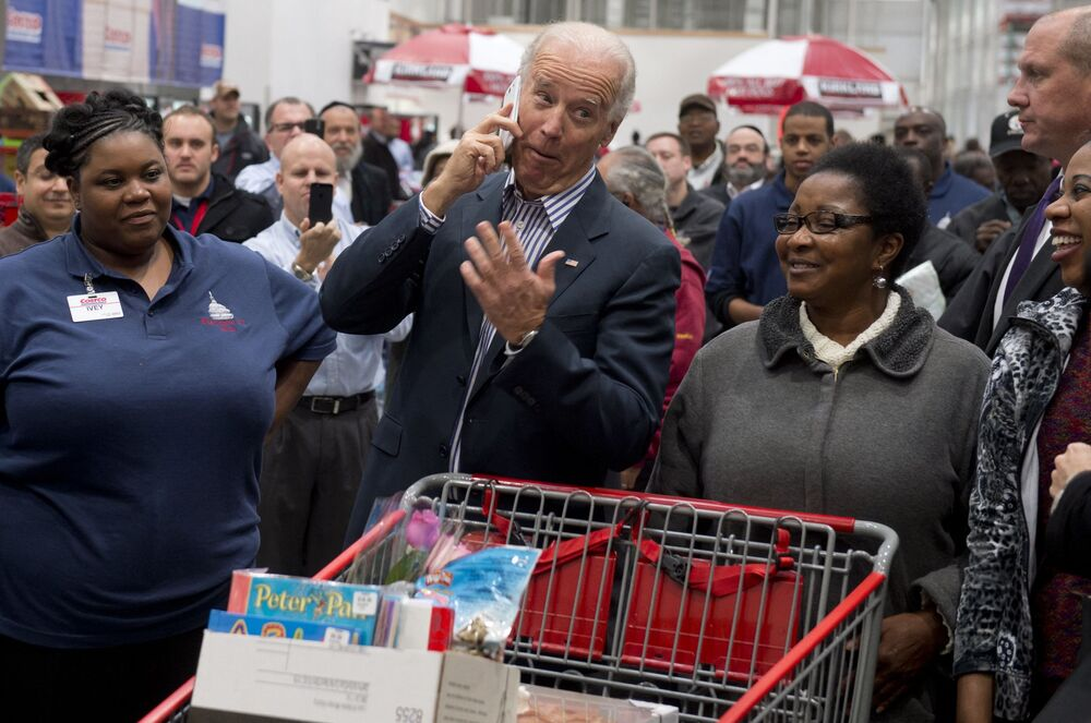 US Vice President Joe Biden talks on an employee's cellphone during a visit to a Costco store on a shopping trip in Washington DC on 29 November, 2012.