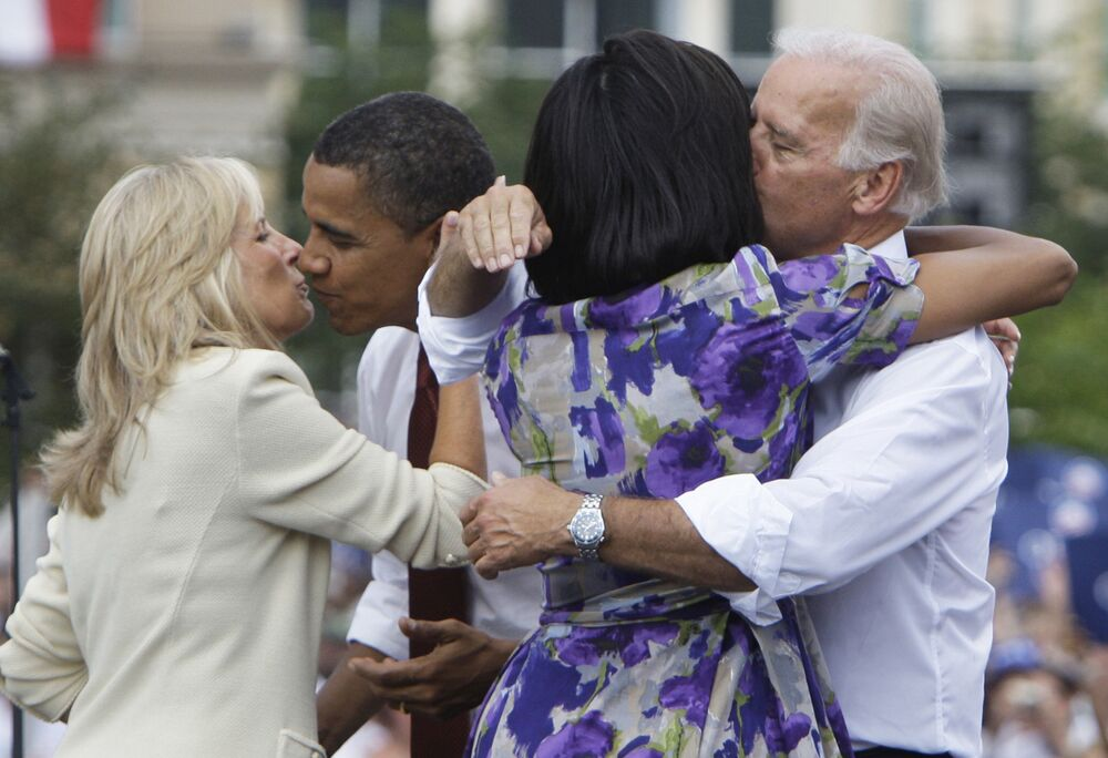 Democratic presidential candidate Sen. Barack Obama D-Ill., kisses Jill Biden, wife of his vice presidential running mate Sen. Joe Biden., while Biden hugs Obama's wife Michelle, right, and at a campaign stop  Saturday, 23 August, 2008 in Springfield, Ill. Obama introduced Biden as his running mate at the event.
