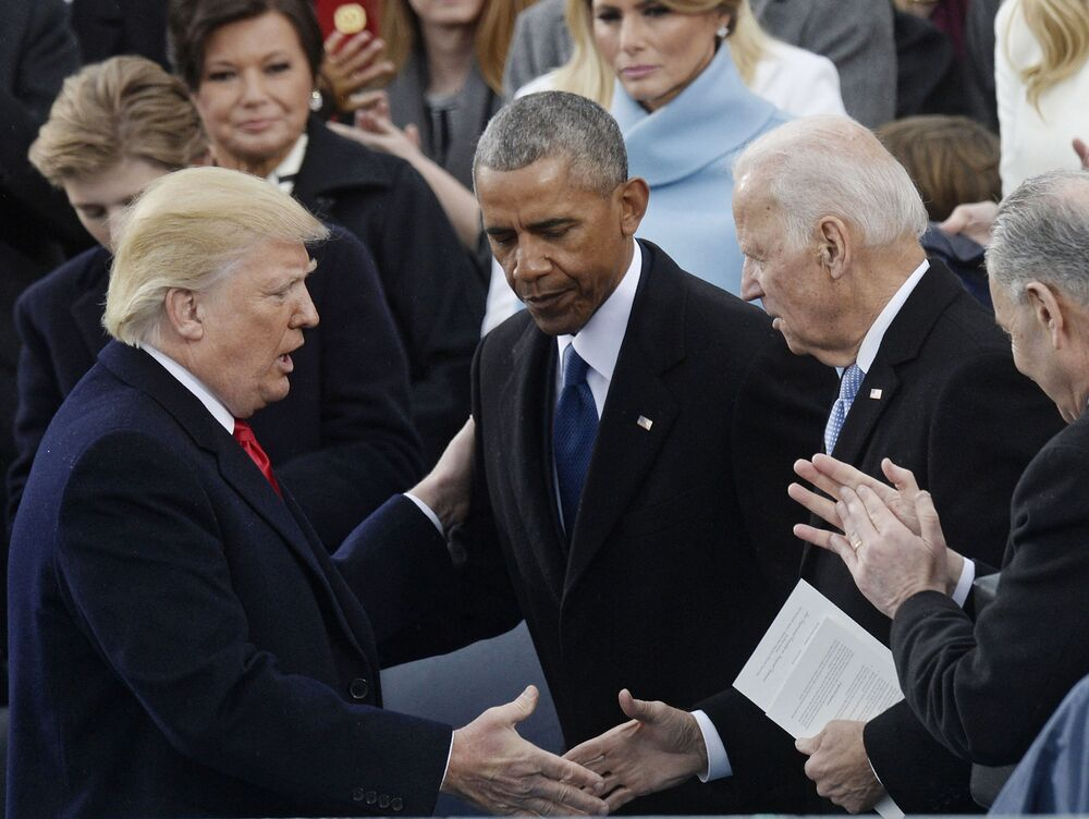 US President Donald Trump, former US President Barack Obama and ex-Vice President of the United States Joe Biden at the inauguration ceremony in Washington in 2017.