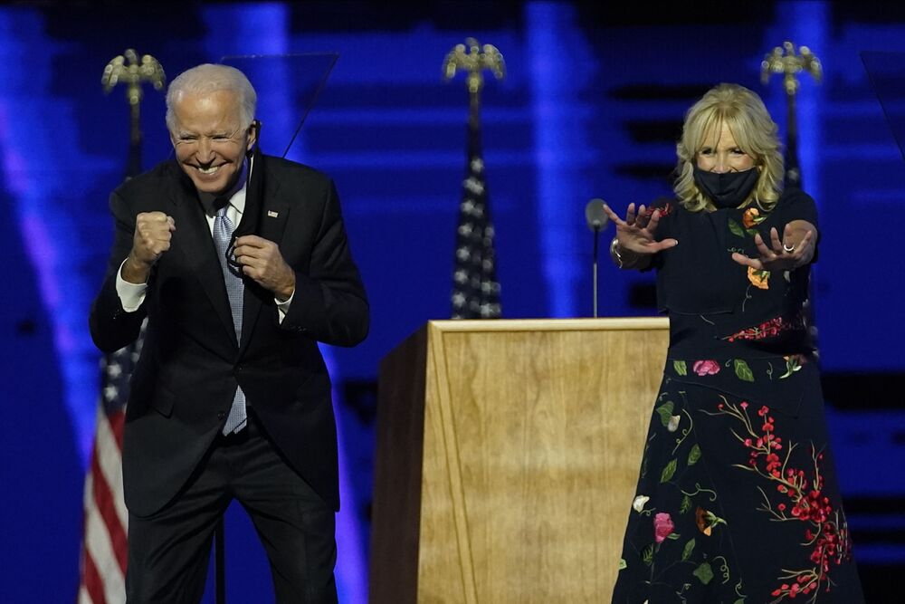 Joe Biden and his wife Jill Biden gesture to supporters Saturday, 7 November, 2020 in Wilmington, Del.