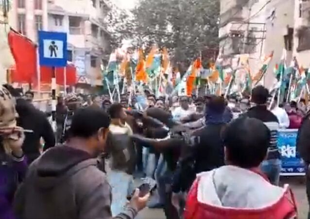 Supporters of India's West Bengal State Ruling Party Beat Member of Paramilitary Force