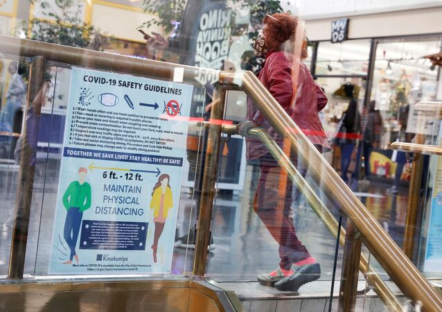 A masked customer ascends a flight of stairs inside Japan Center in Japantown ahead of the new stay-at-home order in attempts to contain the spread of the coronavirus disease (COVID-19) in San Francisco, California, U.S., December 6, 2020