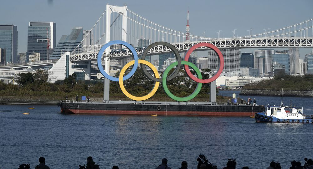 The Olympic Symbol is reinstalled after it was taken down for maintenance ahead of the postponed Tokyo 2020 Olympics in the Odaiba section Tuesday, Dec. 1, 2020, in Tokyo.