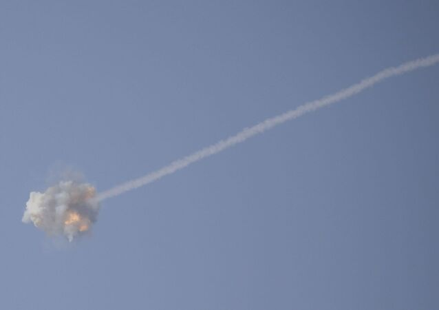 An Israeli Iron Dome air defense system missile is seen intercepting rockets fired from Gaza over Sderot, southern Israel, Wednesday, Nov. 13, 2019.