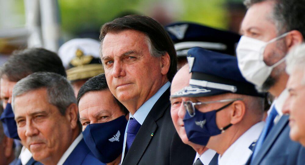 Brazil's President Jair Bolsonaro (C) looks on during a ceremony of Aviator's Day at Brasilia Air Base in Brasilia, Brazil October 23, 2020.