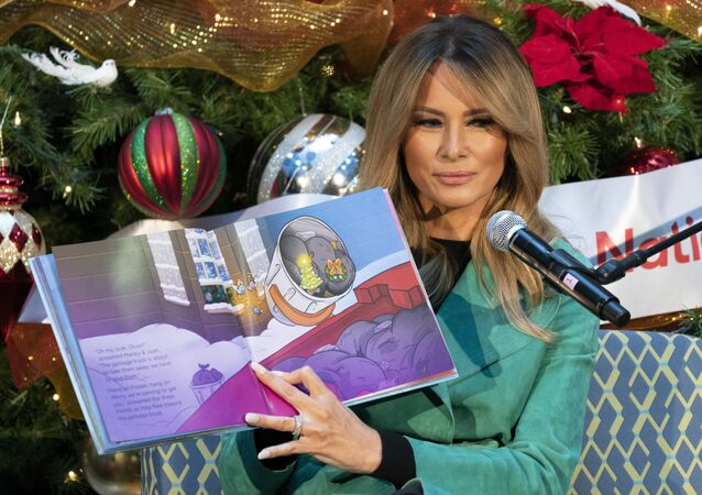 First lady Melania Trump reads a Christmas book titled, Oliver the Ornament Meets Marley and Joan and Abbey, at Children's National Hospital, Tuesday, Dec. 15, 2020, in Washington