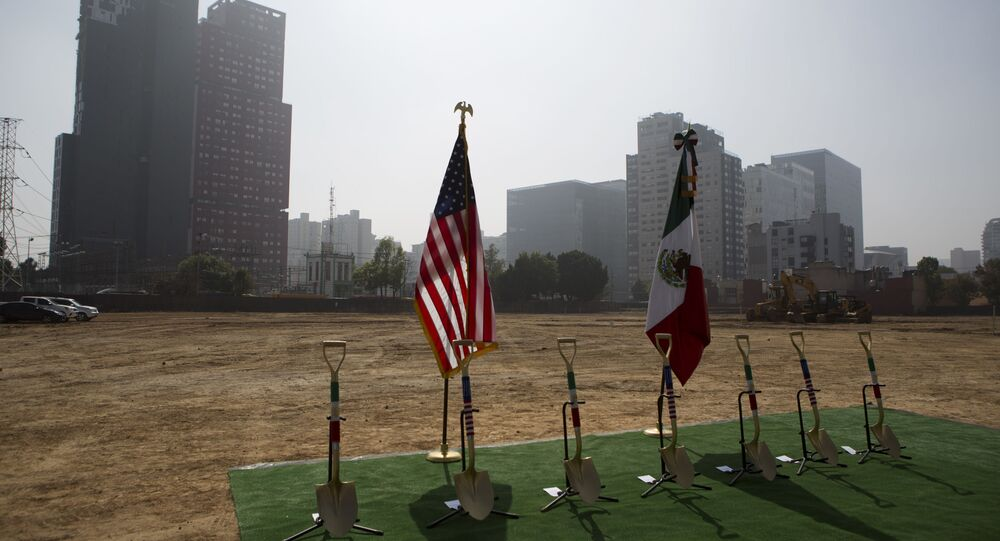 Shovels decorated with the colors of the Mexican and U.S. flags are lined up ahead of a groundbreaking ceremony for the new U.S. embassy, slated to cost nearly $1 billion, in Mexico City, Tuesday, Feb. 13, 2018. Work has begun on the long-awaited new embassy in Mexico City which is being built on a former industrial site that required extensive toxic cleanup and will be one of the most expensive U.S. embassies in the world.