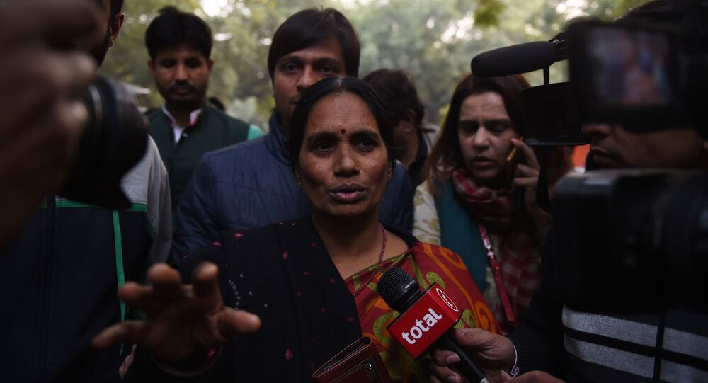 The mother of Indian gangrape victim 'Nirbhaya' (C) talks to the media as she attends a rally held to protest the release of a juvenile rapist, in New Delhi on December 21, 2015.