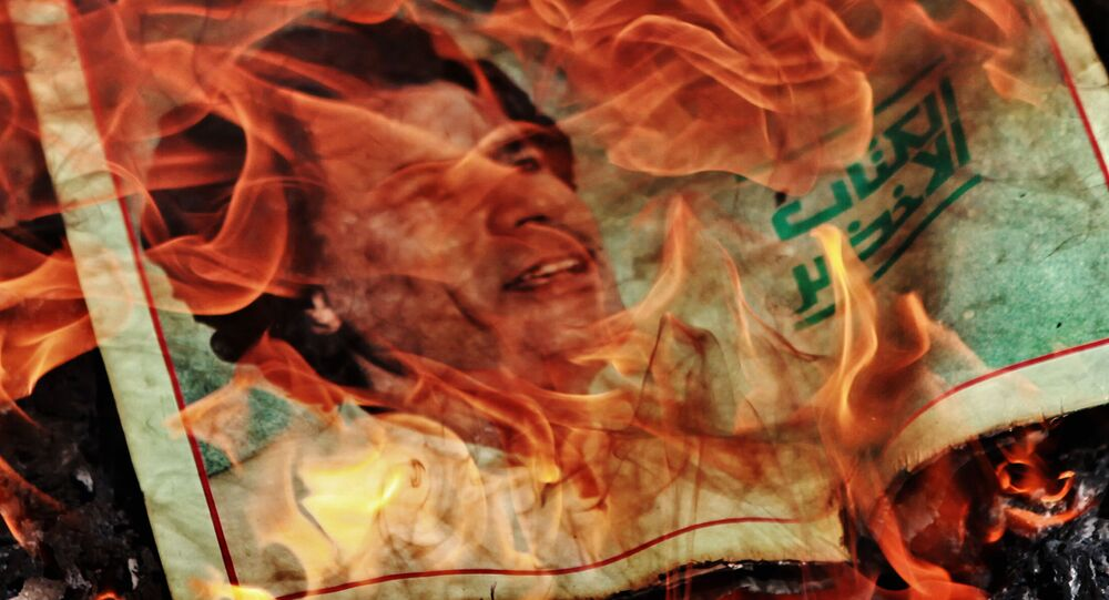 The government of Libya's leader Muammar Gaddafi was overthrown in February 2011. The politician was killed several months later near his home town of Sirte, allegedly by rebel forces.  Above: Portrait of Muammar Gaddafi on fire.